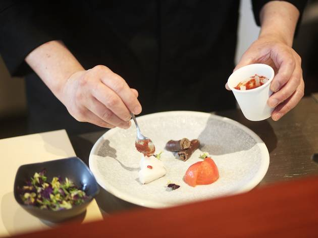 A dish at Kappo being prepared by a chef