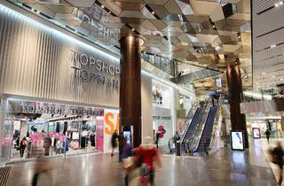 An interior shot at Emporium Melbourne showing escalators and th