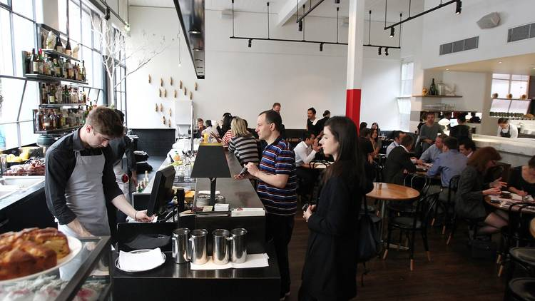 An interior shot at Cumulus Inc showing the bar area as well as