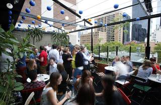 An exterior shot of the rooftop at Loop Roof showing a crowd of