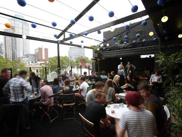 An exterior shot of the rooftop at Loop Roof showing people sitt