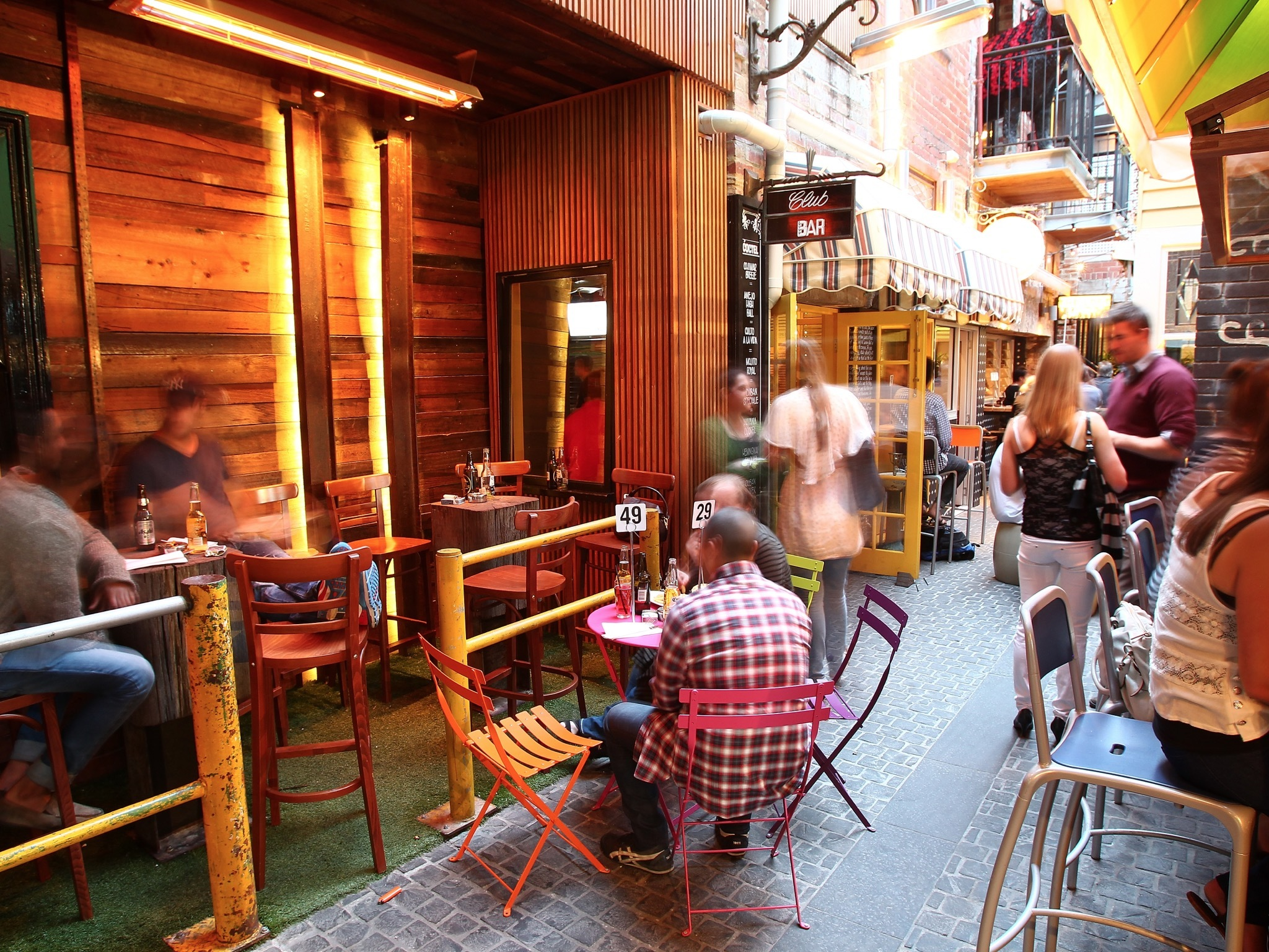 An exterior shot of a laneway at The Bridge Hotel showing people