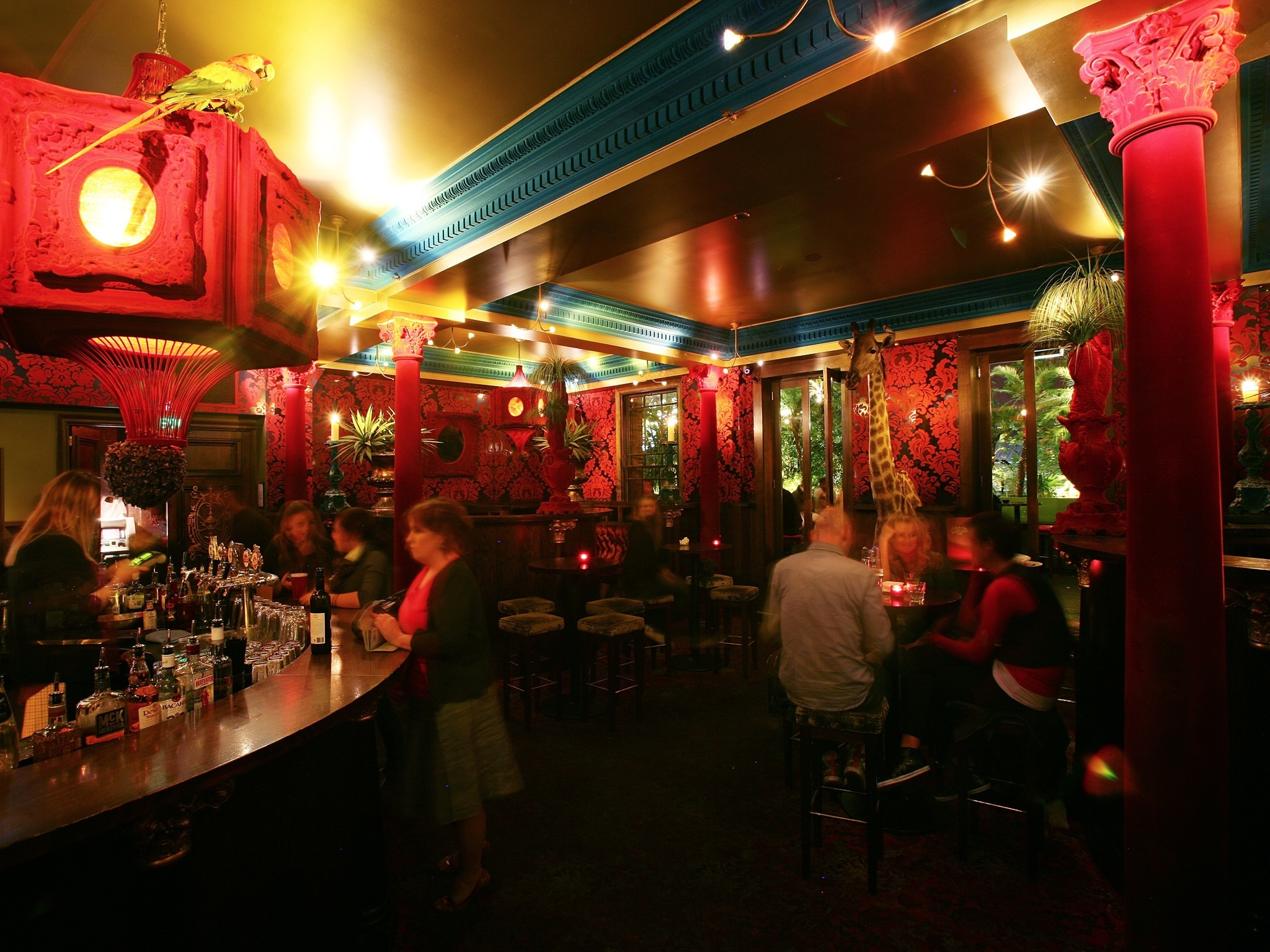 An interior shot of the bar area at Carlton Club showing people