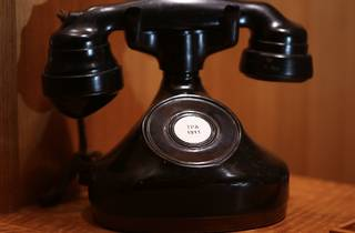 A vintage black telephone on a table at Bar Exuberante