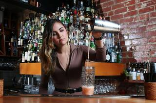 A bartender behind the bar at at Boston Subs's Jungle Boy pourin
