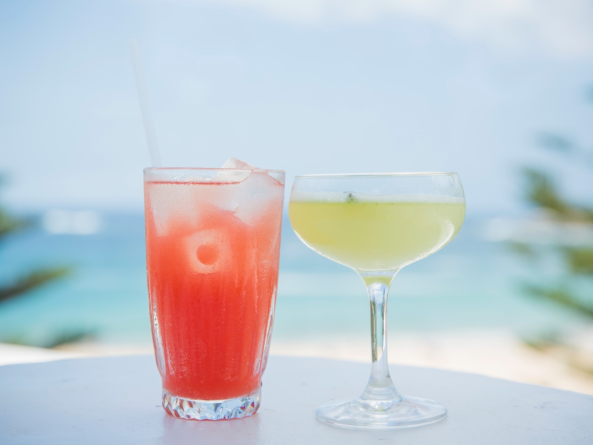 Two drinks with the beach in the background