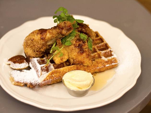 A plate of fried chicken and waffles at Bowery to Williamsburg