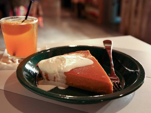Pumpkin pie topped with cream