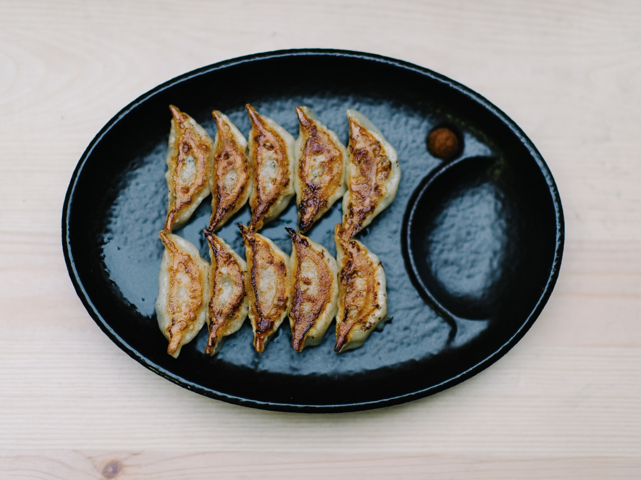 A plate of ten pieces of fried gyoza at Hakata Gensuke