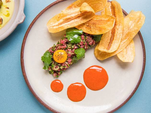 Steak tartare served with plantaine chips and a raw egg yolk