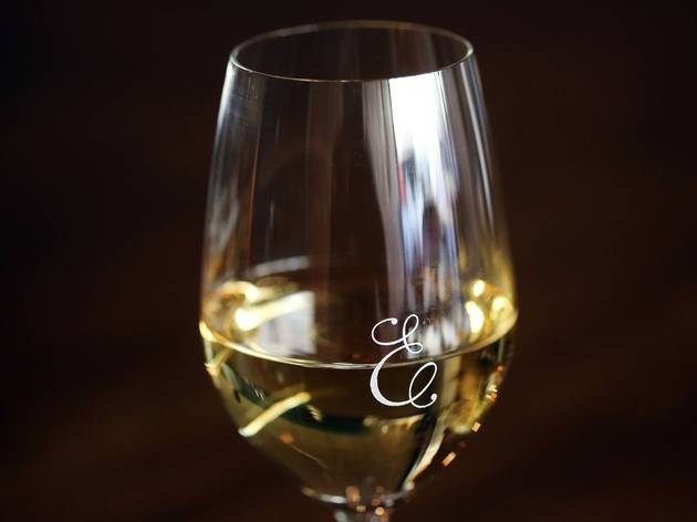 A close up shot of a glass of white wine at Estelle Bistro