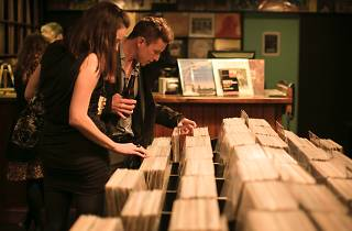 Couple looking through records
