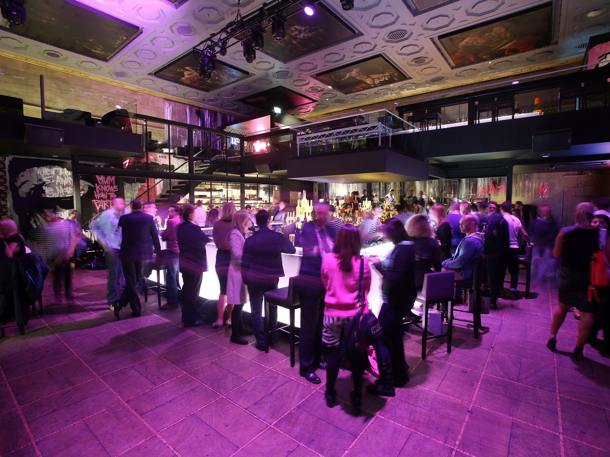 An interior shot of the main bar area with people lining around
