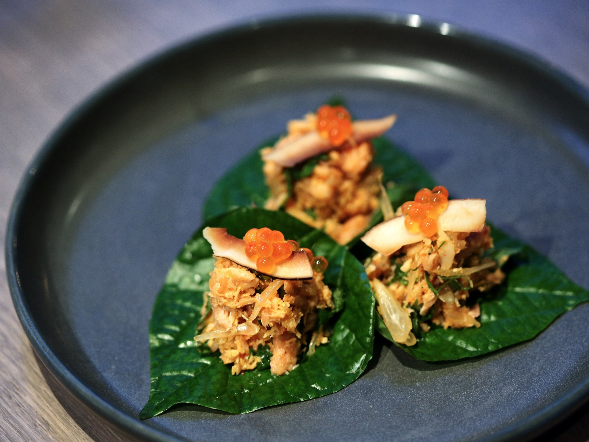 Betel leaf entree topped with salmon roe