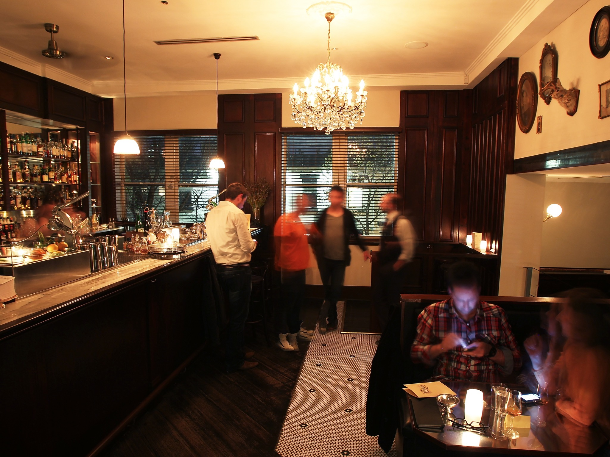 An interior shot at The Everleigh showing people standing and si