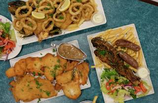 An Array of foods on a blue table