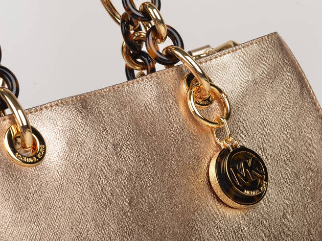 A golden handbag with gold accessories