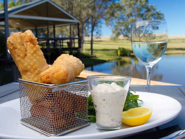 A close up shot of beer battered fish and chips at the Deck Cafe, with the scenery behind