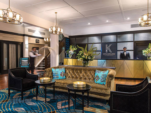 A shot of the lobby area with couches and reception desk at Hotel Kurrajong