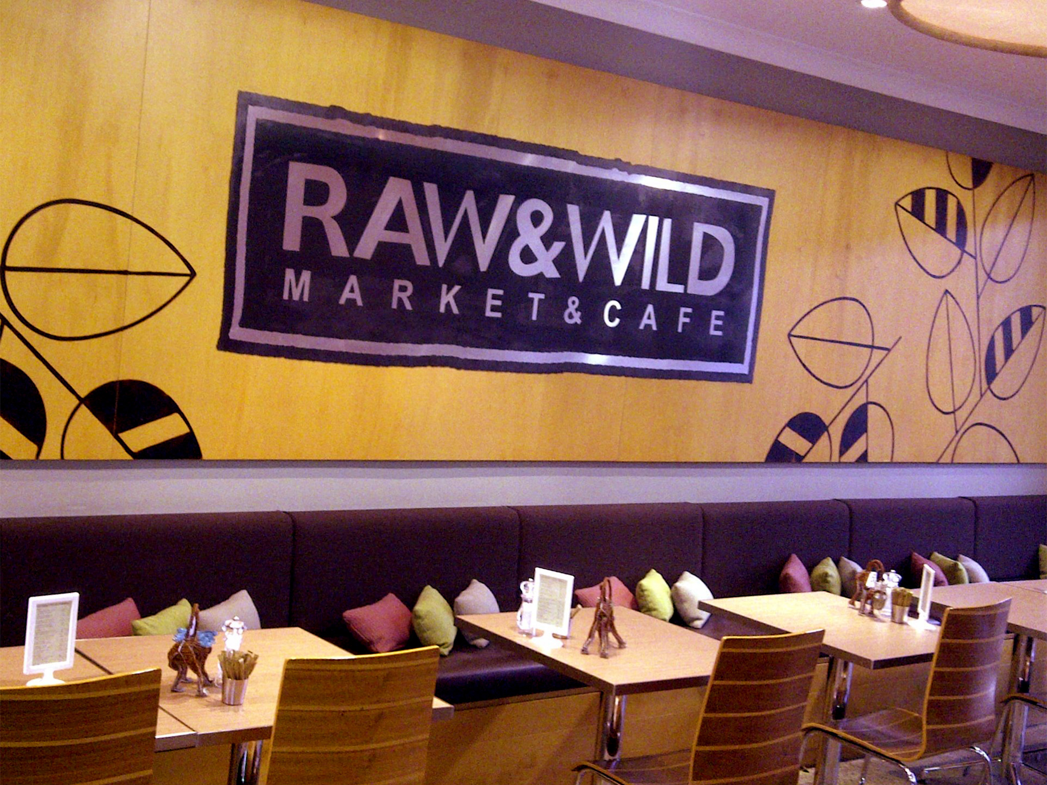 An interior shot of booth seats and tables at Raw & Wild