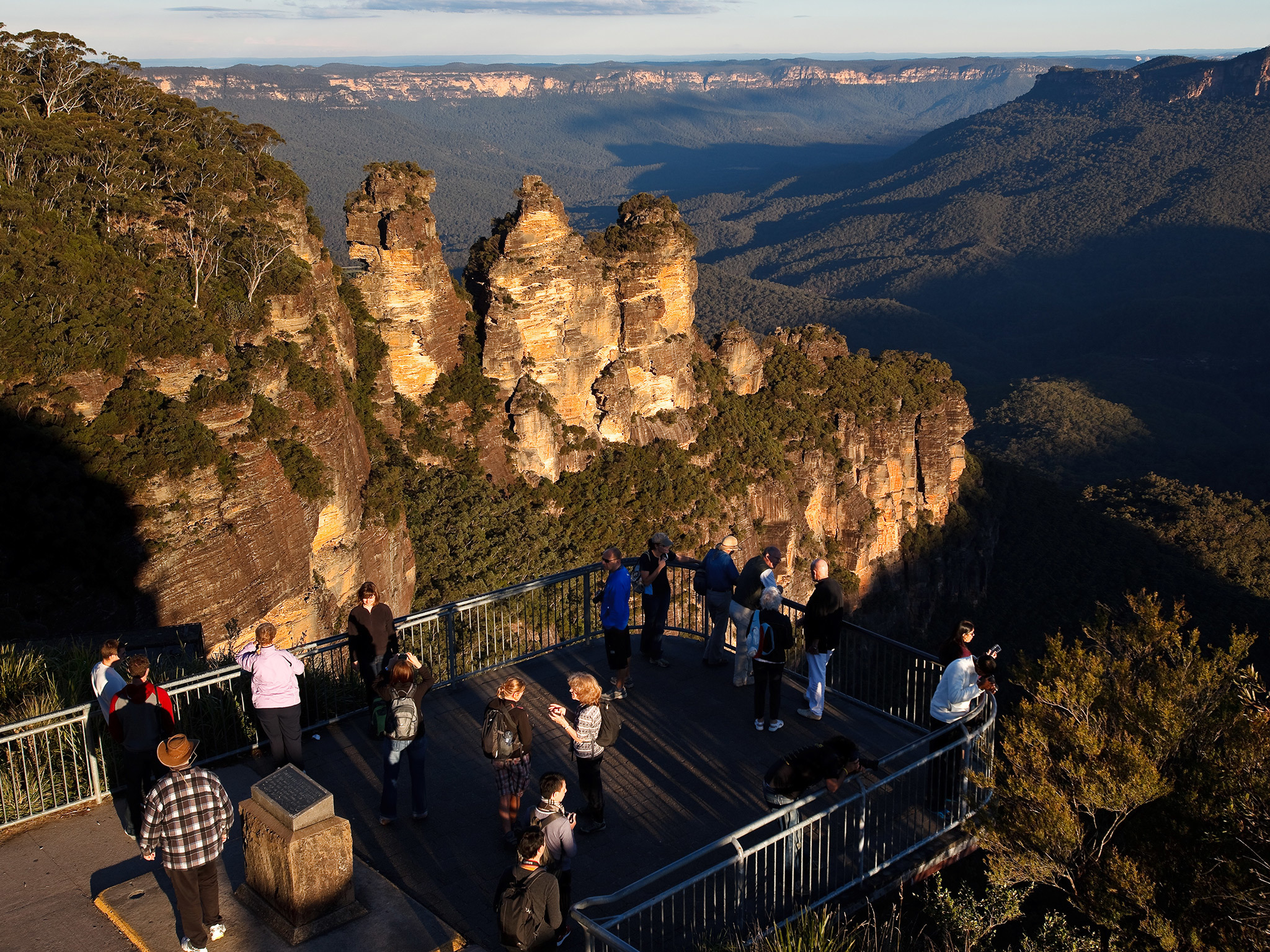 Visitors overlook the Three Sisters from a lookout