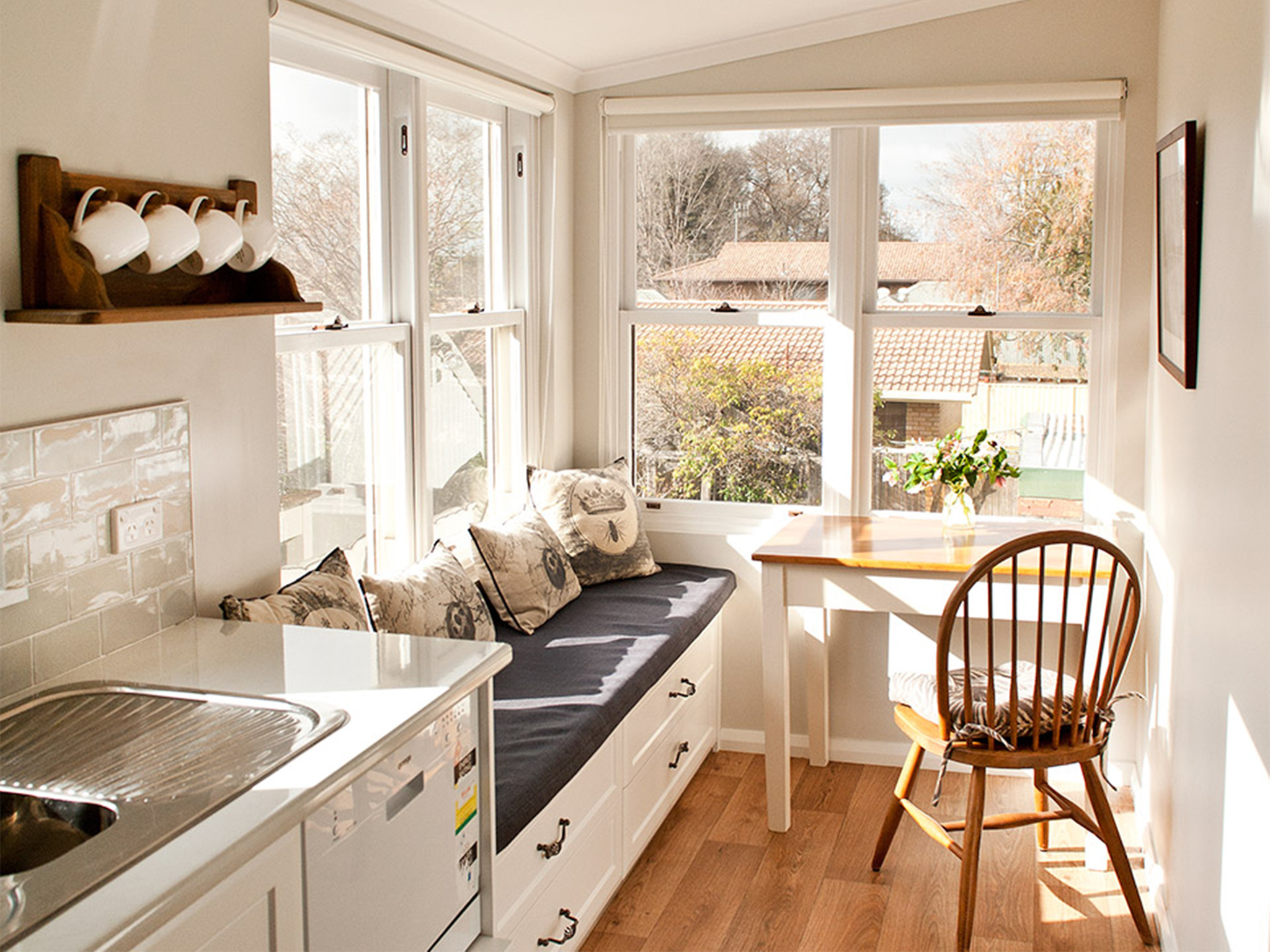 The comfortable seating area of a sunlit kitchen and dining area