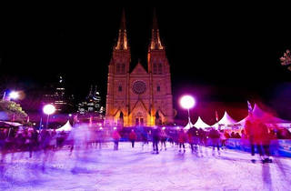 A shot of people ice skating at Sydney Winter Garden at St Mary'