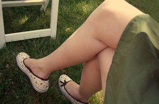 A pair of legs crossed