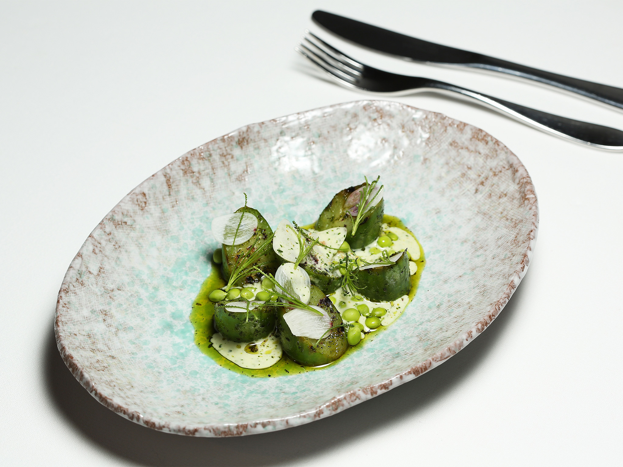 Grilled cucumber spears with a pea reduction