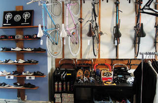 Bikes hang on the wall in a bike shop