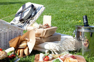 A pre-packaged picnic sits on the grass