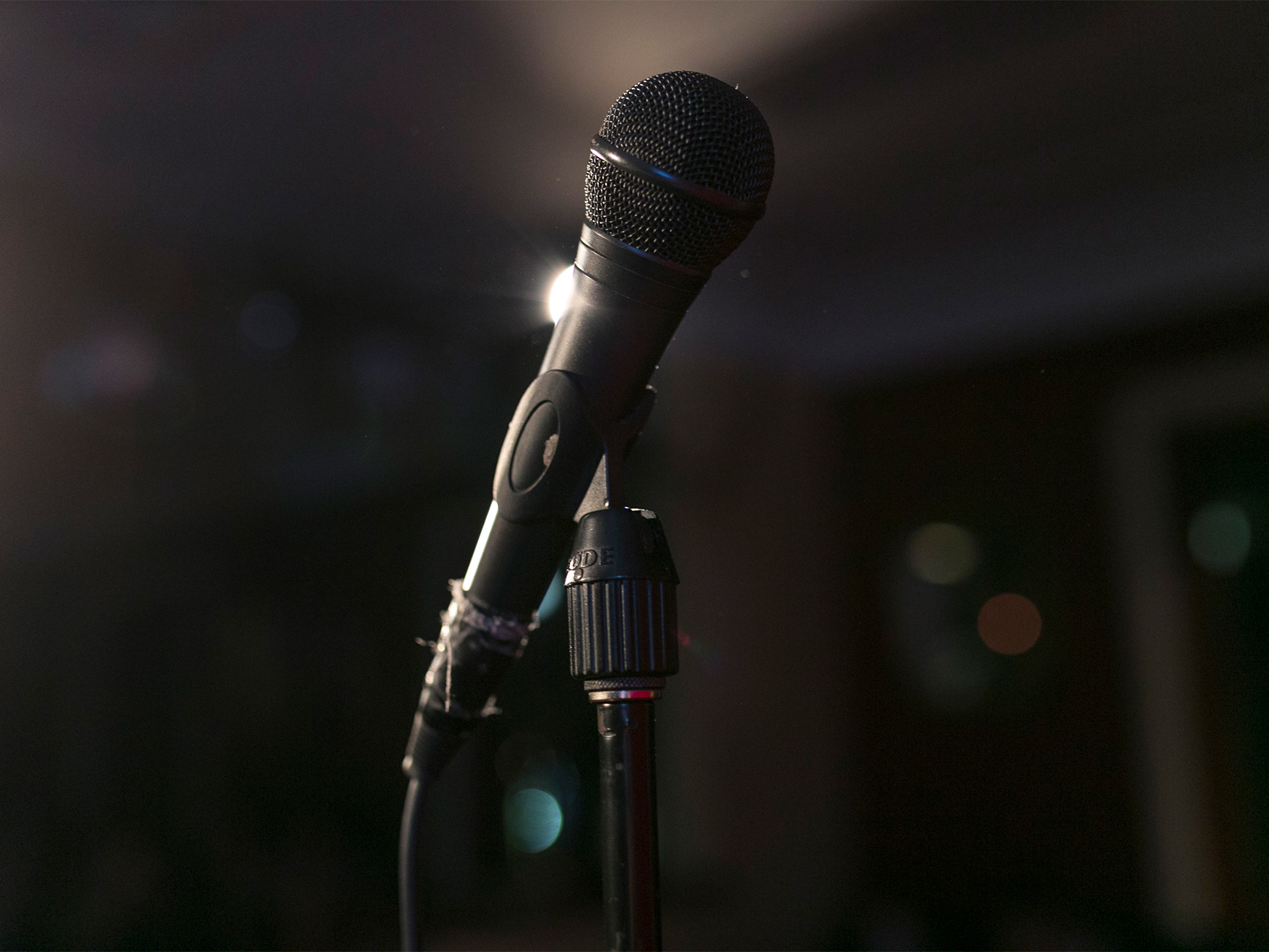 A mic stands on stage