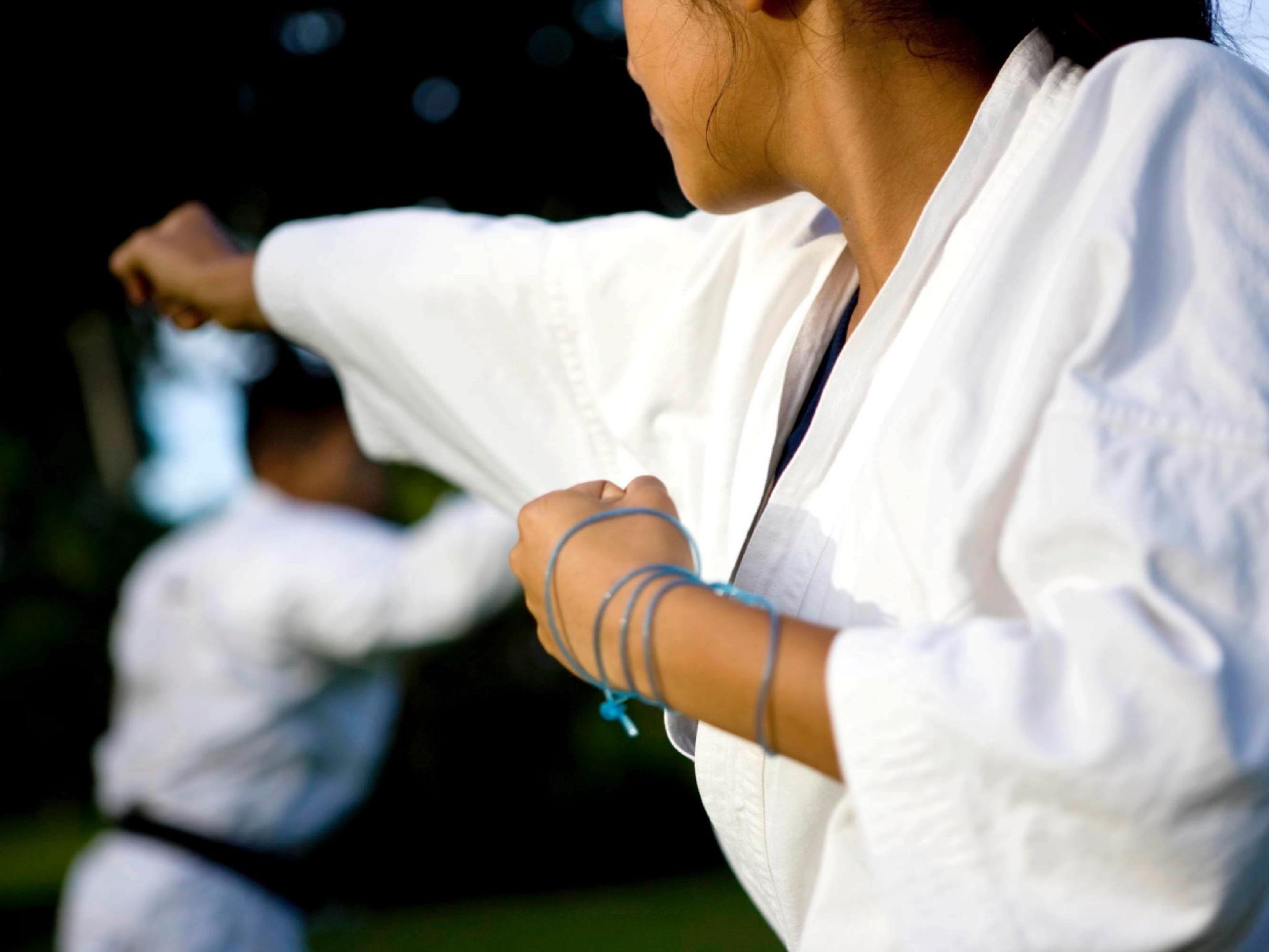 A close up shot of a woman practicing martial arts