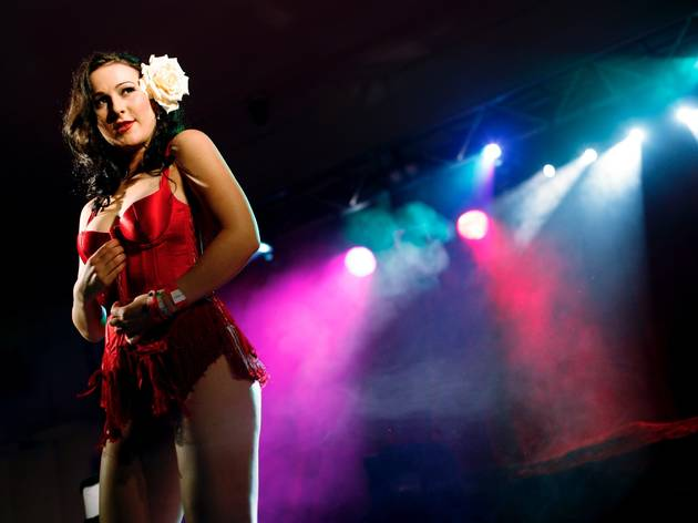 A shot of a female burlesque performer on stage