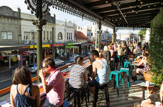 Customers drinking on the upper floor patio at Newtown Hotel