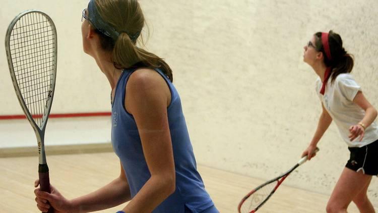 A shot of two women playing squash