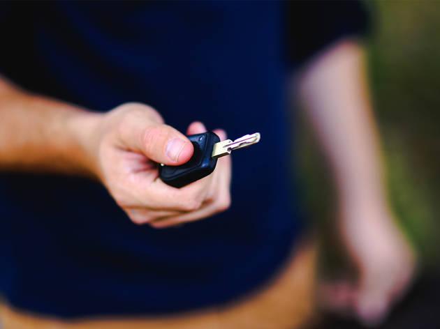 Hand holding a set of car keys
