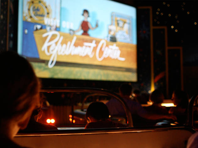 People watching a film at a drive-in cinema