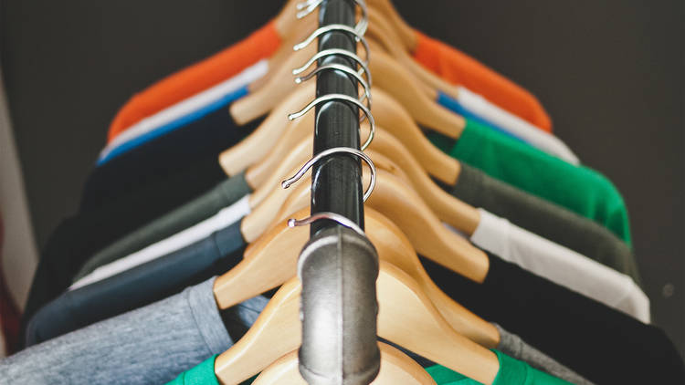 T-shirts are hung up on a clothing tack
