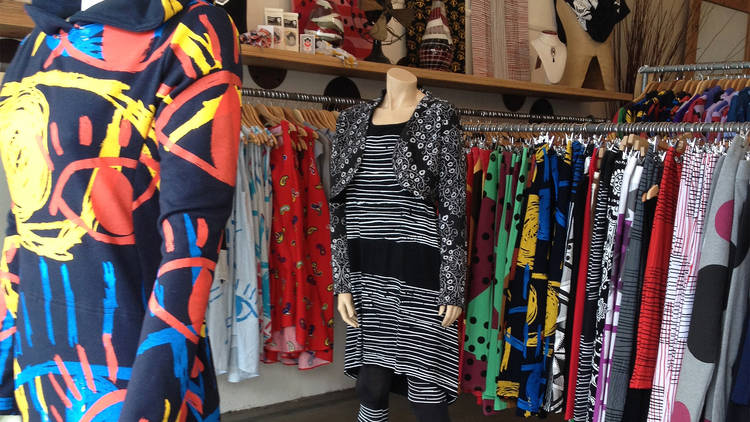 A store filled with colourful items of clothing