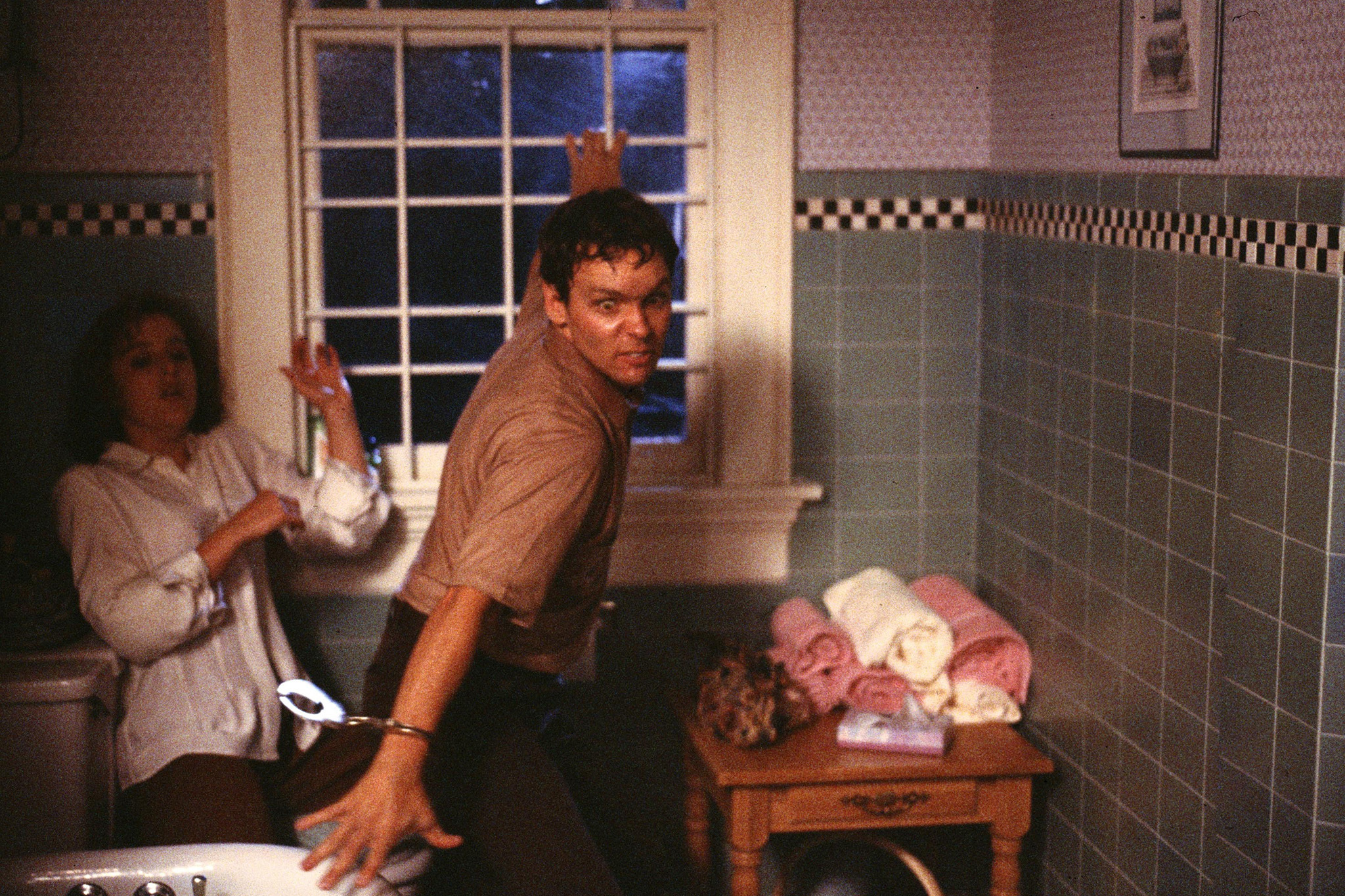 """Gillian Anderson (L) and Doug Hutchison (R) in the """"Squeeze"""" episode of THE X-FILES from season one."""