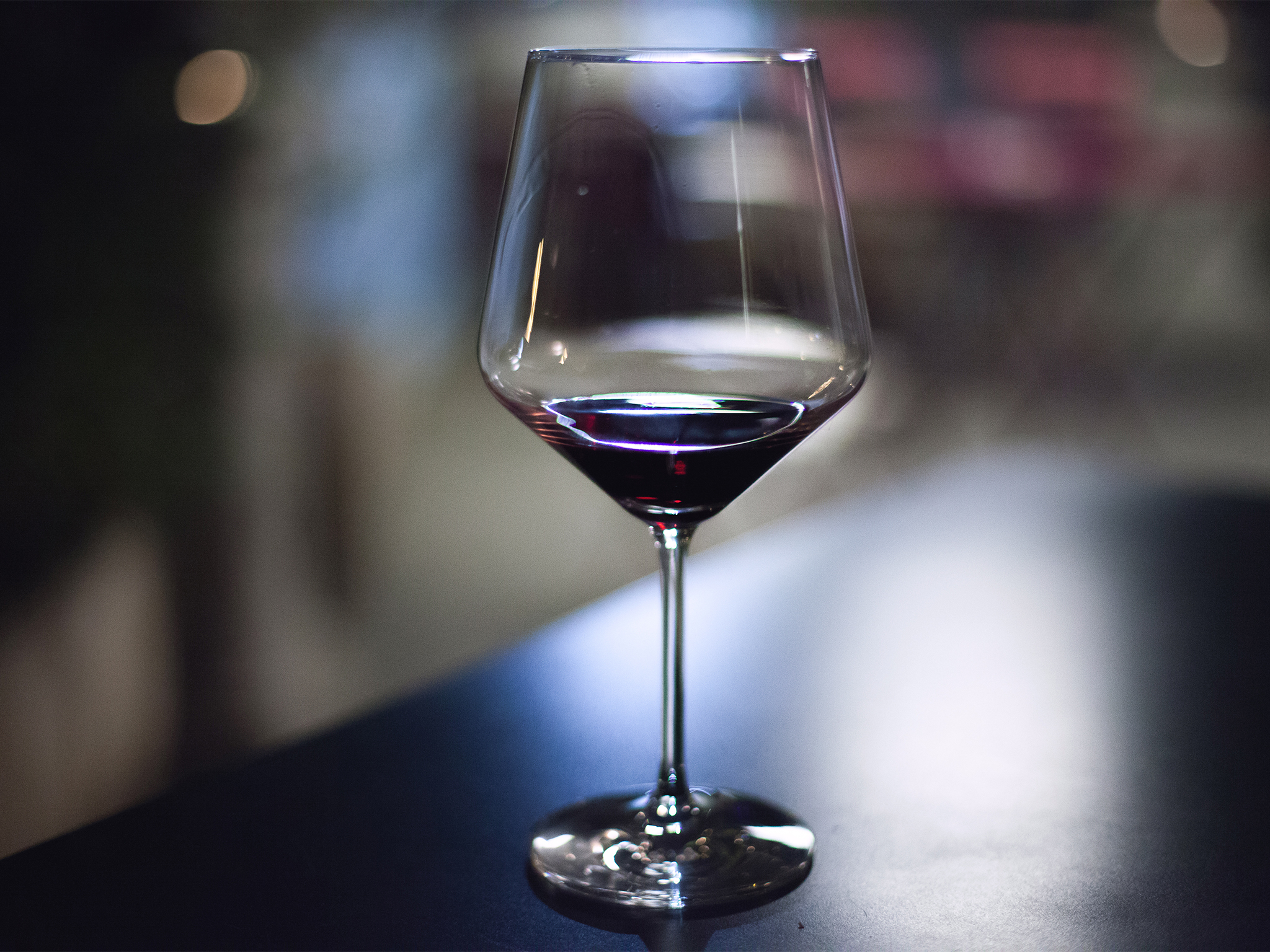 A wine glass with some red wine in it