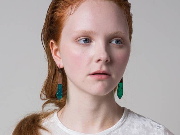 A woman wearing Limedrop earrings