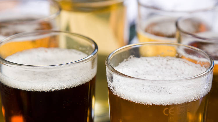 A close up shot of 6 glasses full of beer