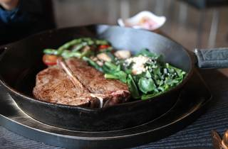 steak with vegetables on a pan
