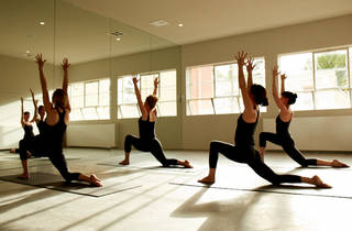 People participating in a yoga class