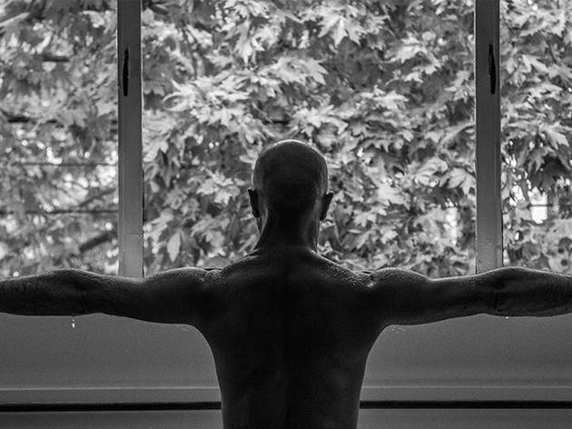 A black and white image of a man doing yoga