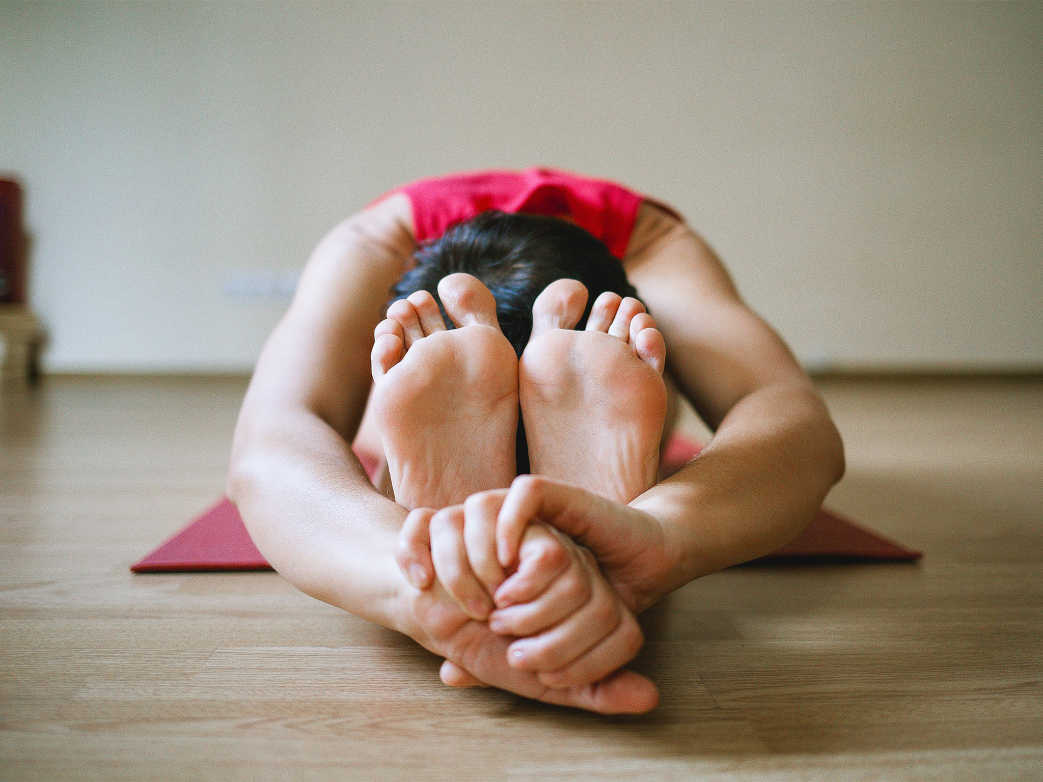 A woman stretching during a yoga class