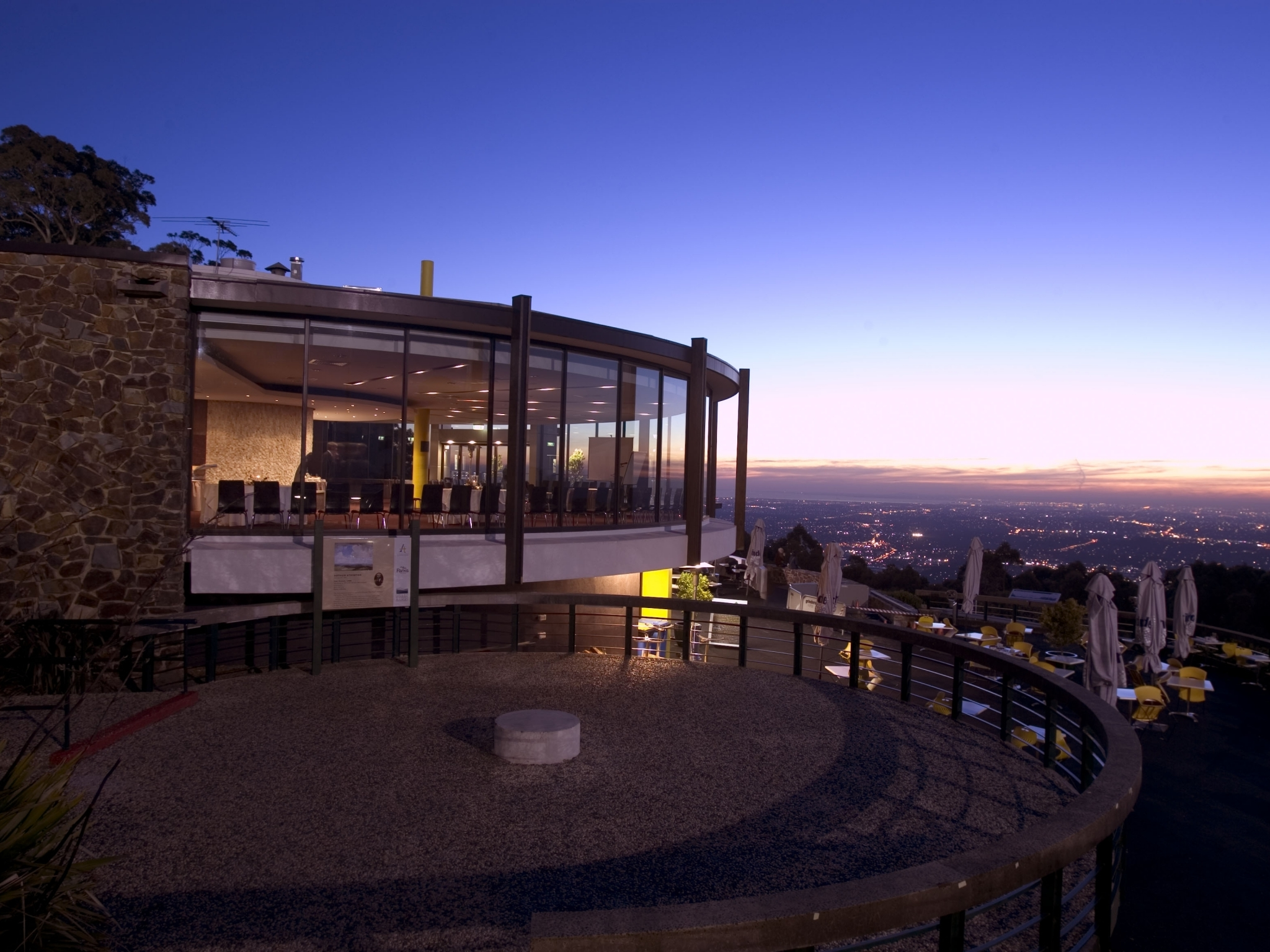 SkyHigh Mount Dandenong restaurant at night with the city below