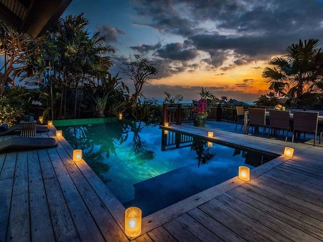 Candles around a pool at Karma Kandara Resort in Bali